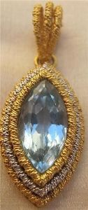 SUPERB 18CT AQUAMARINE PENDANT IN 18CT YELLOW AND WHITE GOLD TOP QUALITY